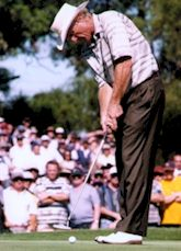 Greg Norman putting